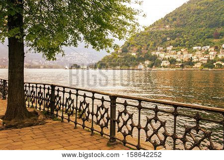 Italy. Quay town of Como on Lake Como at sunset. Lake Como - the third largest lake in the north of Italy Lombardy.