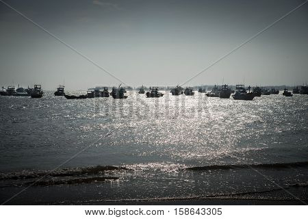 Silhouette of boats on the shores of the Indian Ocean.