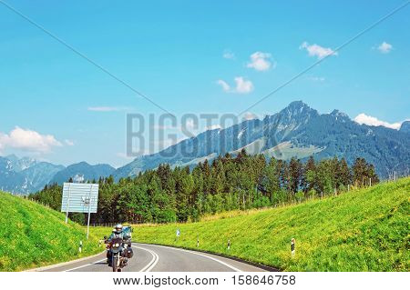 Charmey Switzerland - August 22 2013: Road with motorcycle at Prealps mountains in Gruyere district Canton Fribourg in Switzerland