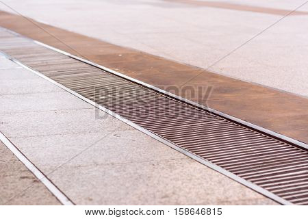 water drain or ditch on floor .