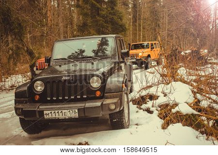 Leningrad Oblast, the Karelian isthmus, Russia,March 15, 2014. off-road check out the Jeep Wrangler Club around the Gulf of Finland, the Jeep Wrangler is a compact four wheel drive off road and sport utility vehicle