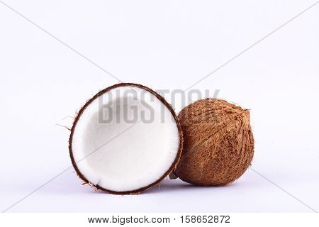 fresh coconut half clipping path for coconut milk and brown coconut shell  on white background fruit food isolated