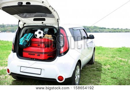 Car trunk with luggage. Travel concept