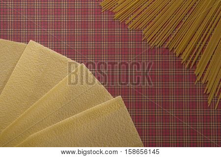 Lasagne sheets and spaghetti pasta background. Flat lay. Top view. Close up. Food background concept.