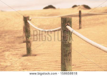 Fence in sand desert