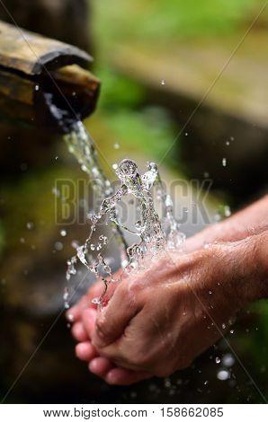 Hands washing with water splash