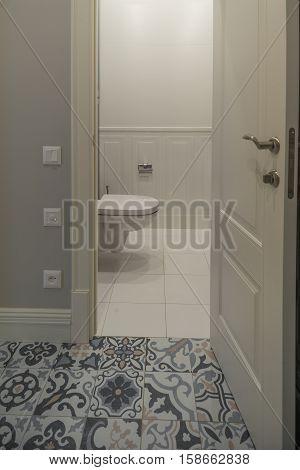 the toilet room with the door open