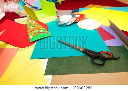 A set of tools and board for making greeting cards for New Year, Christmas and holidays.