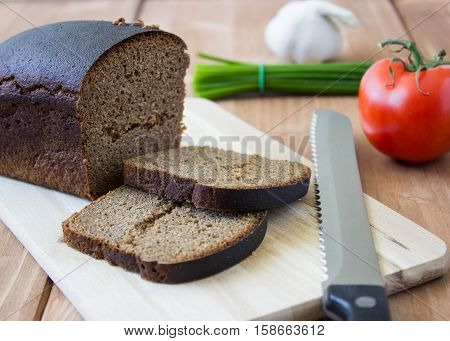 Ingredients for salate , bread on wooden background.