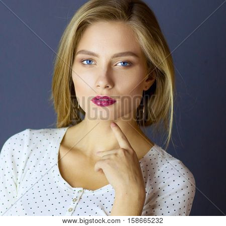 Portrait of woman with arms crossed, isolated on white background