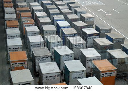 DELHI, INDIA - FEBRUARY 19: Top view of containers cargo truck on the ground in the Delhi airport on February 19, 2016. Indira Gandhi International Airport is the 32th busiest in the world.