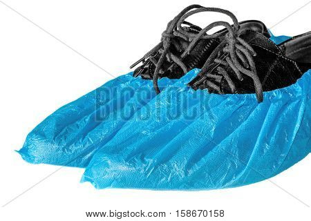 Shoes in shoe covers isolated on white background