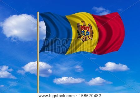 Moldovan national official flag. Patriotic symbol banner element background. Correct colors. Flag of Moldova on flagpole waving in the wind blue sky background. Fabric texture. 3D rendered illustration