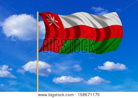 Omani national official flag. Patriotic symbol banner element background. Correct colors. Flag of Oman on flagpole waving in the wind blue sky background. Fabric texture. 3D rendered illustration