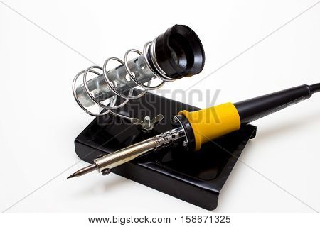 Electric soldering iron with solder on support