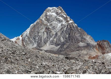 Rocky Mountain Peak In Sagarmatha National Park, Himalayas, Nepal. Mountain Summit On A Clear Bright