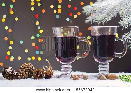 Hot mulled wine with cones in the snow