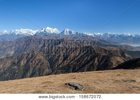 Stunning Mountain Landscape With Dark Brown Rocky Mountains On The Foreground And White Snowy Mounta