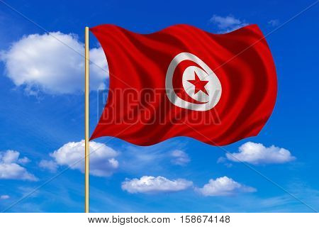 Tunisian national official flag. African patriotic symbol banner element background. Correct colors. Flag of Tunisia on flagpole waving in the wind blue sky background. Fabric texture. 3D rendered illustration