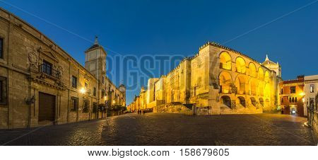 Mezquita Cathedral or The Great Mosque illuminated at dusk in Cordoba, Andalusia, Spain