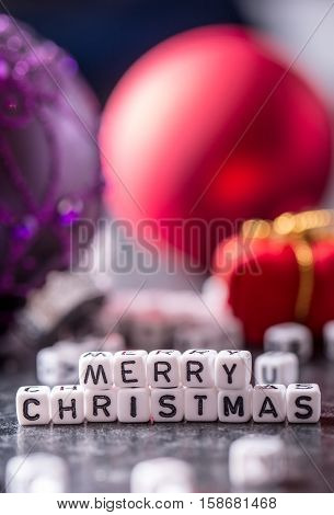 Christmas. Christmas Time. Christmas decoration.The words Merry Christmas with red christmas decorations.