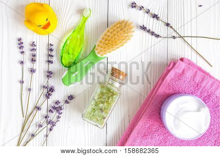 baby accessories with lavander for the bathroom on wooden background top view