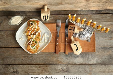 Beautiful composition for Hanukkah on wooden table