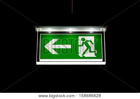 Modern Exit Sign Glass White Illuminated On Black Background Interior