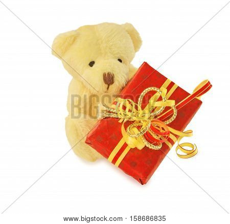 Teddy bear classic soft toy sitting with red gift box isolated over white. Front view.