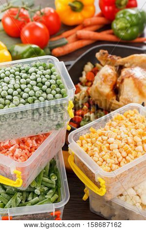 Frozen vegetables in plastic containers fried chicken in pan. Healthy paleo diet food and meals.