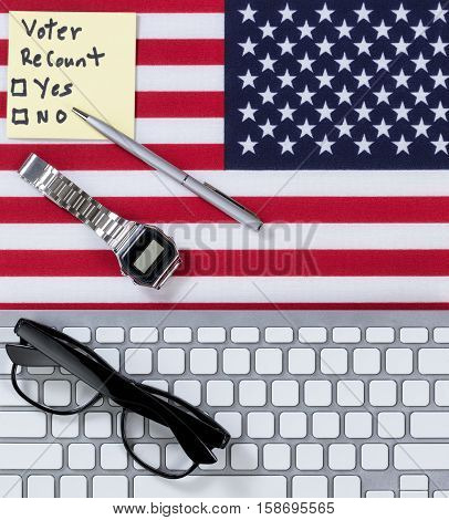 Keyboard with USA Flag read glasses watch pen and decision paper to do a recount on the election.