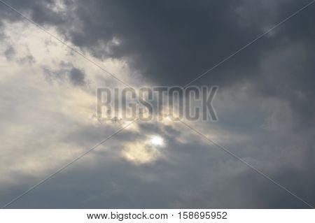 rain cloud hide the sun on dull sky