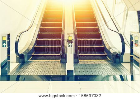 Escalator(black and metallic color) in shopping mall.