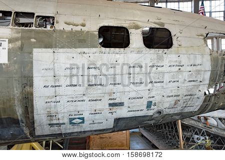 DAYTON, OHIO, USA-NOVEMBER 18, 2016:National Museum USAF is restoring WWII The Swoose Flying Fortress bomber the oldest B-17 & only D model in existence. Shown here with countries visited on fuselage.
