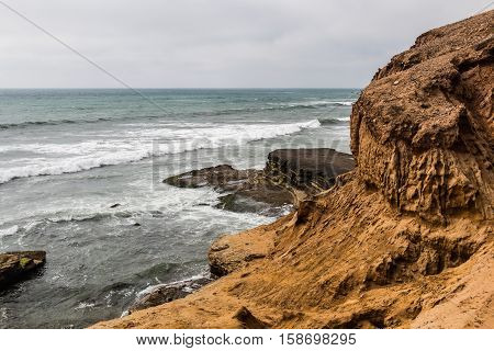 Cliffside erosion and ocean at the Point Loma tidepools in San Diego, California.