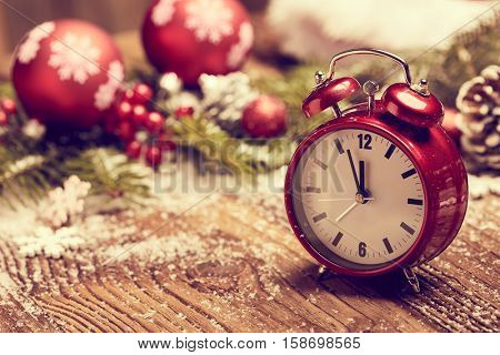 New Year's clock. Decorated with gift box and decorations background. Celebration Concept for New Year Eve.