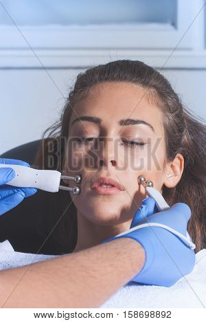 woman face treatment at medical spa center poster