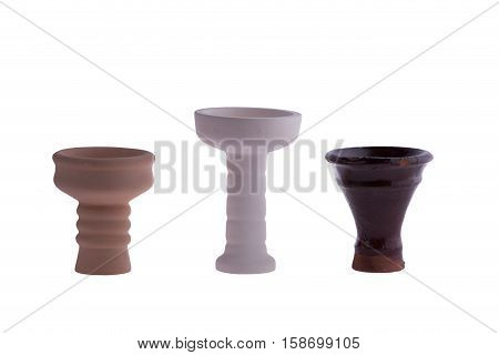 hookah bowl for tobacco shisha pottery, three ceramic products, brown, beige and dark brown ceramic vessel standing in a row, three clay vessels