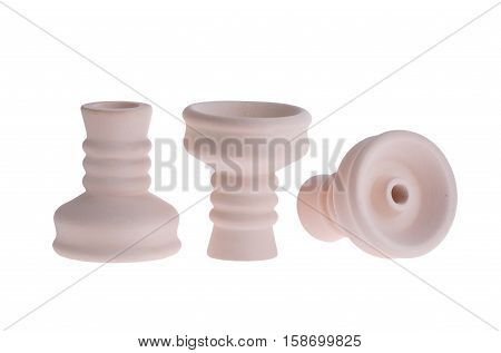 hookah bowl for tobacco shisha three figured pottery, three ceramic products, clay bowls arranged in a row, three beige vessels with curly legs, one vessel stands right and second reversed and third lays