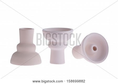 hookah bowl for tobacco shisha three figured ceramic products, three figured pottery, three clay vessels arranged in a row, three beige clay vessels with short legs, one vessel stands right and second reversed and third lays