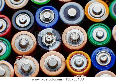 Energy Abstract Background Of Colorful Batteries.
