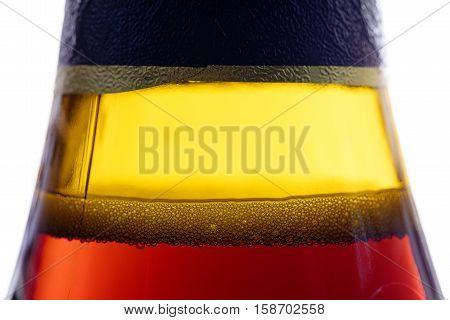 Bubbles in the bootle of the beer Dark beer bubbles in the bottle beer close up. Red beer bottle. Opened beer bottle close up view. Sticker on beer bottle.