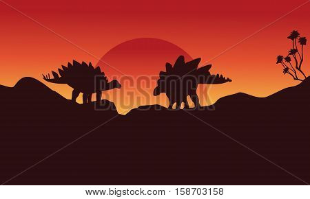 Silhouette of two stegosaurus on the cliff scenery vector