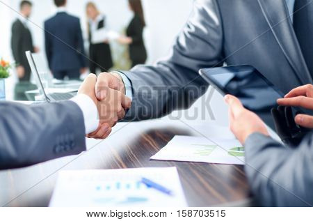 concept - benefits from successful cooperation. the handshake bu