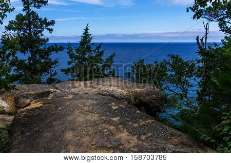 Cliff overlooking beautiful crystal clear waters of Lake Superior.