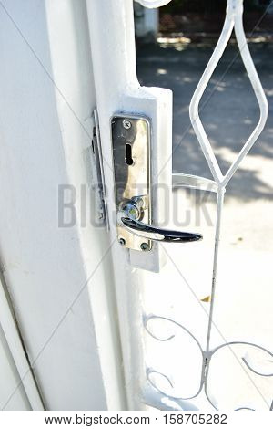 White wrought iron door handles and locks.
