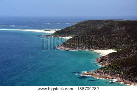 Coastline of Shoal bay on a sunny day from Mount Tomaree Lookout (Central Coast NSW Australia)