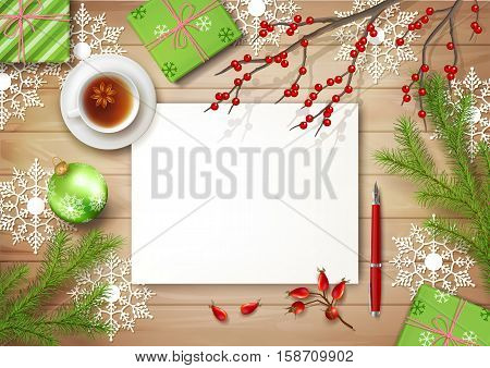 Christmas vector top view background with cup of tea, blank paper sheet, fir twigs, gifts, Christmas ball on wooden table