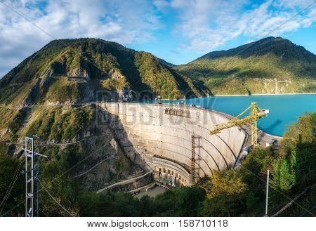 The Enguri hydroelectric power station HES. The wide Inguri River Jvari Reservoir next to Enguri Dam surrounded by mountains Upper Svaneti Georgia. Second highest concrete arch dam in the world. Jvari location.