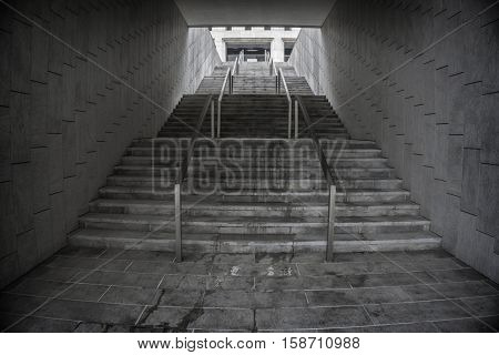 Staircase in underground passage. Rise to the top. Exit.